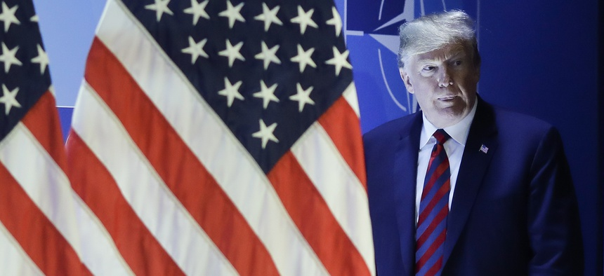 U.S. President Donald Trump arrives for a news conference during a summit of heads of state and government at NATO headquarters in Brussels on Thursday, July 12, 2018.
