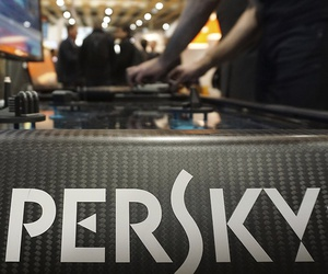 A Kaspersky employee shuffles tokens around a table-top display at the company's stand at a cybersecurity conference in Lille, northern France, Wednesday, Jan. 25, 2017.