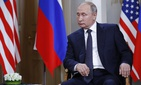 Russian President Vladimir Putin listens at the beginning of a meeting with U.S. President Donald Trump at the Presidential Palace in Helsinki, Finland, Monday, July 16, 2018.