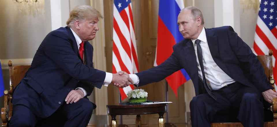 U.S. President Donald Trump, left, and Russian President Vladimir Putin shake hand at the beginning of a meeting at the Presidential Palace in Helsinki, Finland, Monday, July 16, 2018.