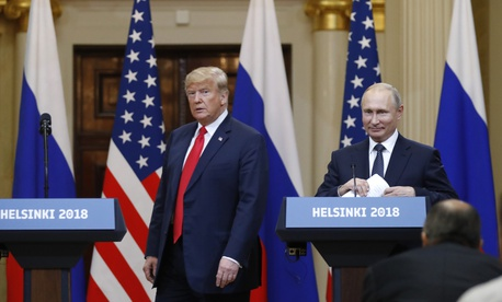 U.S. President Donald Trump, left, and Russian President Vladimir Putin arrive for a press conference in Helsinki, Finland, Monday, July 16, 2018.