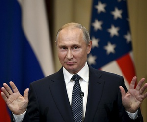 Russian President Vladimir Putin gestures during a joint press conference with U.S. President Donald Trump at the Presidential Palace in Helsinki, Finland, Monday, July 16, 2018.