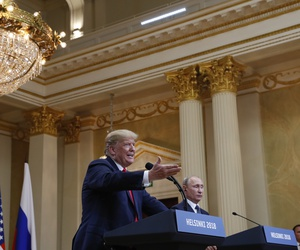 U.S. President Donald Trump, center, gestures while speaking as Russian President Vladimir Putin looks on during their joint news conference at the Presidential Palace in Helsinki, Finland, Monday, July 16, 2018.