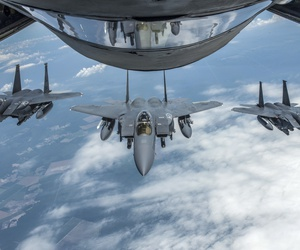 F-15E Strike Eagles with the 4th Fighter Wing at Seymour Johnson Air Force Base, N.C., form up behind a KC-135 Stratotanker with the 121st Air Refueling Wing, Ohio Air National Guard, June 15, 2018.