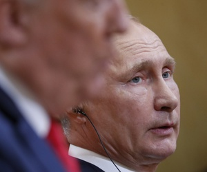 Russian President Vladimir Putin, right, listens to U.S. President Donald Trump, right, speak during their joint news conference at the Presidential Palace in Helsinki, Finland, Monday, July 16, 2018.