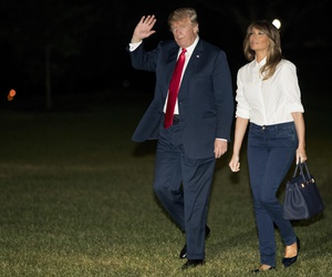 President Donald Trump and first lady Melania Trump walk across the South Lawn of the White House in Washington, Monday, July 16, 2018. Trump returns following a meeting with Russian President Vladimir Putin in Helsinki, Finland.