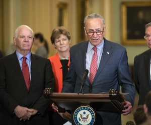 Senate Minority Leader Chuck Schumer, D-N.Y., joined from left by, Sen. Ben Cardin, D-Md., Sen. Jeanne Shaheen, D-N.H., and Sen. Bob Menendez, D-N.J., criticizes President Donald Trump and his Helsinki summit during a news conference July 17, 2018.