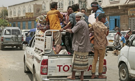 Displaced Yemenis, who fled their homes by the fighting the port city of Hodeida, arrive in Sanaa, Yemen, Saturday, Jun. 23, 2018.