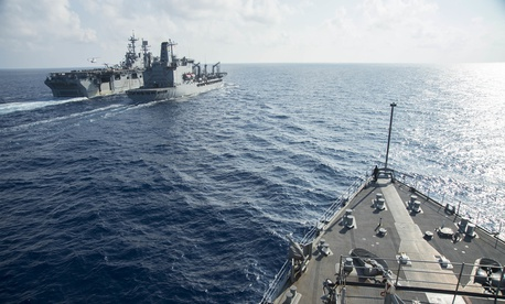 The Whidbey Island-class amphibious dock landing ship USS Germantown (LSD 42) approaches the Military Sealift Command fleet replenishment oiler UNSN Walter S. Diehl (T-AO 193) in the South China Sea in 2016.