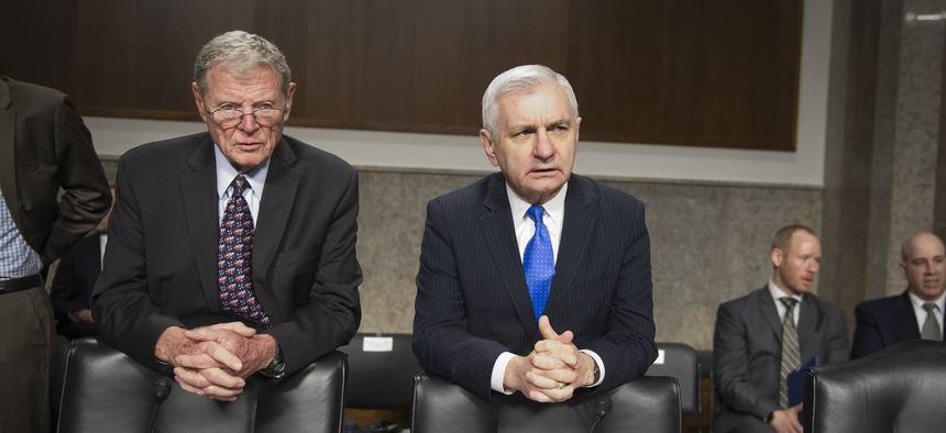 Senate Armed Services Committee Chairman James Inhofe, R-Ok., left and ranking member Jack Reed, D-R.I., talk before a hearing in March 2018.