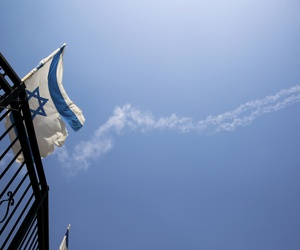 Trails of Patriot missiles are seen in the sky in northern Israel Tuesday, July 24, 2018. Israel shot down a Syrian fighter jet it said had breached its airspace on Tuesday while advancing Syrian government forces reached the Golan Heights frontier.