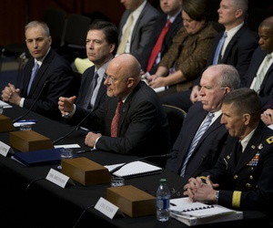 Director of National Intelligence James Clapper, center, testifies on Capitol Hill in Washington, Jan. 29, 2014. From left are, National Counterterrorism Center Director Matthew Olsen, FBI Director James Comey, Clapper, and CIA Director John Brennan.