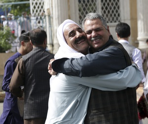 Men hug each other after Eid al-Fitr prayers outside of Shah-e-Dushamshera mosque in Kabul, Afghanistan, Friday, June 15, 2018. Taliban, an insurgent group, announced that they will start a 3-day ceasefire, starting in the first day of Eid al-Fitr.