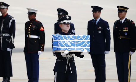 A soldier carries a casket containing a remain of a U.S. soldier who was killed in the Korean War during a ceremony at Osan Air Base in Pyeongtaek, South Korea, July 27, 2018. The U.N. Command said the 55 cases of war remains retrieved from North Korea wi