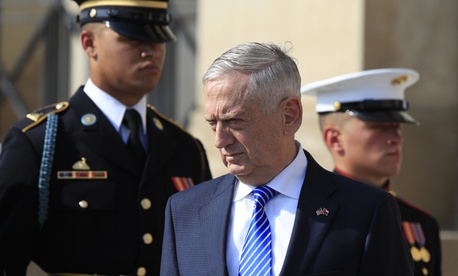 Secretary of Defense Jim Mattis, stands on the steps of the River entrance to the Pentagon, Friday, July 27, 2018.