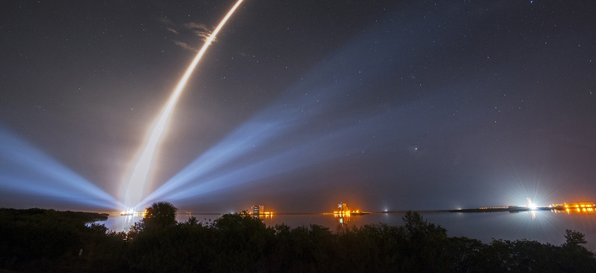A United Launch Alliance (ULA) Atlas V rocket carrying the third Mobile User Objective System satellite for the U.S. Navy creates a light trail as it lifts off on Jan. 20, 2015.