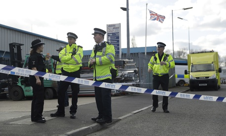"olice officers secure a cordon outside the vehicle recovery business ""Ashley Wood Recovery"" in Salisbury, England, Tuesday, March 13, 2018."