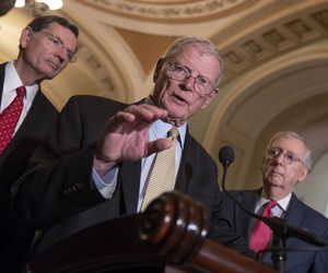 Sen. James Inhofe, R-Okla., a member of the Senate Armed Services Committee, center, joined by Sen. John Barrasso, R-Wyo., left, and Senate Majority Leader Mitch McConnell, R-Ky., talks about defense funding on Capitol Hill in Washington, June 12, 2018.