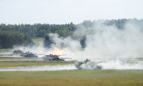 A Challenger II main battle tank from the United Kingdom fires its main gun. U.S. Army Europe and the German Army co-host the third Strong Europe Tank Challenge at Grafenwoehr Training Area, June 3 - 8, 2018.