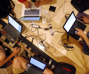 Hackers participate in a competition at the DefCon conference Friday, Aug. 5, 2011, in Las Vegas.