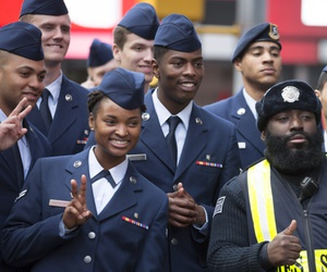A group of U.S. Air Force personnel take a picture with a Times Square Public Safety Officer after the annual Americas Parade up 5th Avenue on Veterans Day in Manhattan in 2015.