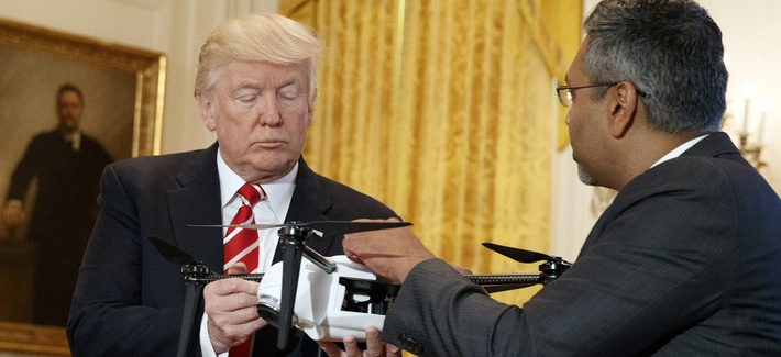 "George Mathew, CEO of Kespry, shows a drone to President Donald Trump during the ""American Leadership in Emerging Technology"" event in the East Room of the White House, Thursday, June 22, 2017."
