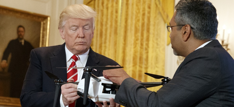 """George Mathew, CEO of Kespry, shows a drone to President Donald Trump during the """"American Leadership in Emerging Technology"""" event in the East Room of the White House, Thursday, June 22, 2017."""