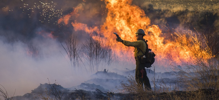 The Thomas Fire burns in the hills above Los Padres National Forest during a firing operation on December 20, 2017.