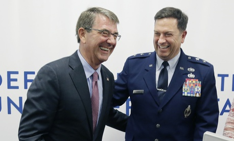 Defense Secretary Ash Carter, left, laughs with Major General Gary W. Keefe, July 26, 2016, in Cambridge, Mass. Carter appeared in Cambridge to formally open the second office of DIUx, near the Massachusetts Institute of Technology.