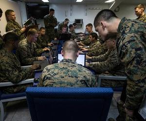 U.S. Marines assigned to Battalion Landing Team, 2nd Battalion, 6th Marine Regiment (BLT 2/6), 26th Marine Expeditionary Unit (MEU), conduct simulated squad-level integrated training with Virtual Battlespace Simulator.