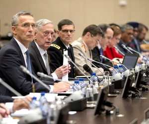 U.S. Secretary for Defense Jim Mattis, center right, and NATO Secretary General Jens Stoltenberg, center left, prepare to make the opening address during a round table meeting of NATO defense ministers and the Coalition to Defeat the Islamic State in 2017