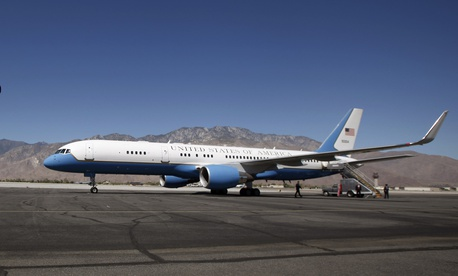 Air Force One crew chief Jeremiah Broersma salutes as a U.S. Air Force C-32 prepares to take off in Palm Springs, Calif., on July 13, 2011.