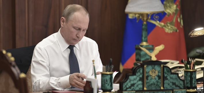 Vladimir Putin sits in his Kremlin cabinet prior his inauguration ceremony as new Russia's president in Moscow, Russia, Monday, May 7, 2018. Putin won the six-year term in March elections where he tallied 77 percent of the vote.