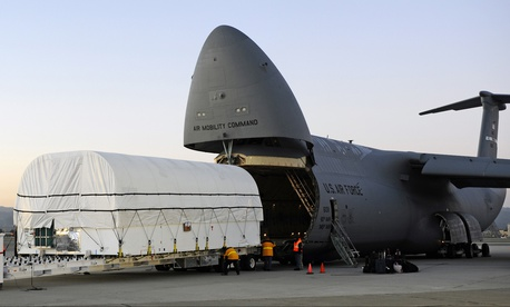 At Moffett Field in Sunnyvale Calif., technicians load the SBIRS GEO-2 satellite aboard a U.S. Air Force C-5B in preparation for shipment to Cape Canaveral Air Force Station, Fla., on Jan. 11, 2013.