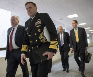 From left, former CIA Director John Brennan, former National Security Agency Director Michael Rogers, and James Clapper, former director of National Intelligence, arrive to talk with senators about Moscow's meddling in the 2016 campaign on May 16, 2018.