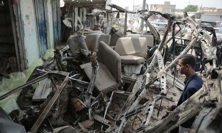 A man inspects the wreckage of a bus at the site of a deadly Saudi-led coalition airstrike on Thursday, in Saada, Yemen, Sunday, Aug. 12, 2018.