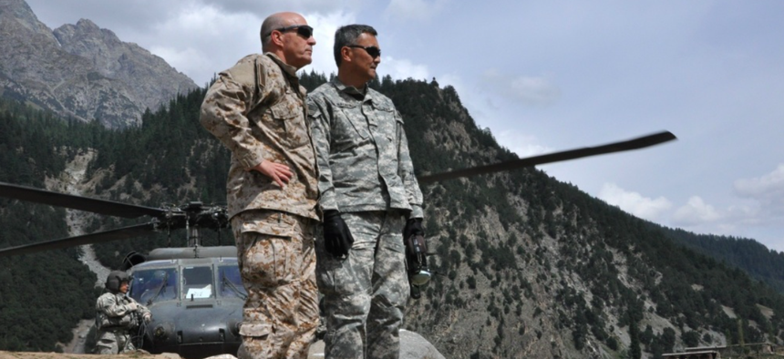 Brig. Gen. Mike Nagata, (left) deputy chief of the Office of the Defense Representative Pakistan and Vice Admiral Mike LeFever, commander of ODRP, watch as relief supplies are offloaded from a U.S. Army UH-60 Black Hawk in Uthror, Pakistan in 2010.