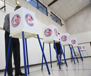 People vote in election booth polling station in a gymnasium in Oak View, California, November 4, 2014.