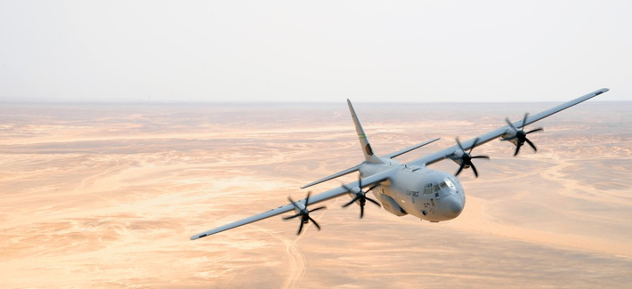 A C-130J Hercules aircraft from the 115th Airlift Squadron at Channel Islands Air National Guard Station, Calif., flies over Jordan during Exercise Eager Lion May 31, 2014, at an air base in northern Jordan.