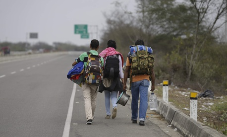 Venezuelan Omar Mujica, right, walks to Lima along the shoulder of the Pan-American Highway with other Venezuelan migrants after crossing the border from Ecuador into Peru, near Tumbes, Peru, Sunday, Aug. 26, 2018.