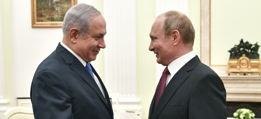 In this Wednesday, July 11, 2018 file photo, Russian President Vladimir Putin, right, shakes hands with Israeli Prime Minister Benjamin Netanyahu during their meeting at the Kremlin in Moscow.