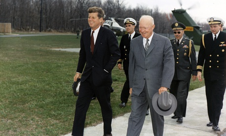 Meeting with President Eisenhower. President Kennedy, President Eisenhower, military aides in Camp David, Maryland, April 22, 1961.