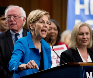 Sen. Elizabeth Warren, D-Mass., center, accompanied by Sen. Bernie Sanders, I-Vt., left, and Sen. Kirsten Gillibrand, D-N.Y., right, speaks during a news conference on Capitol Hill  Wednesday, Sept. 13, 2017, to unveil their Medicare for All legislation.