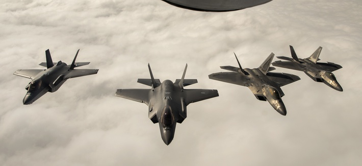 Two F-22 Raptors fly with two Norwegian F-35s in Norway.