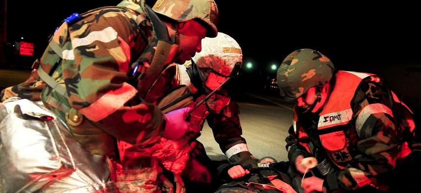 Members of the 51st Civil Engineer Squadron assist a casualty during an active shooter scenario in a 2012 exercise at Osan Air Base, Republic of Korea.