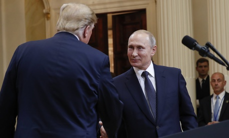 U.S. President Donald Trump, left, and Russian President Vladimir Putin, right, shake hands at the conclusion of their joint news conference at the Presidential Palace in Helsinki, Finland, Monday, July 16, 2018.