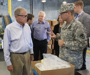 Col. Sean M. Herron (right), commander, McAlester Army Ammunition Plant, Oklahoma, talks to Sen. James Inhofe (R-Okla.) about the different ingredients that are loaded into a bomb body.