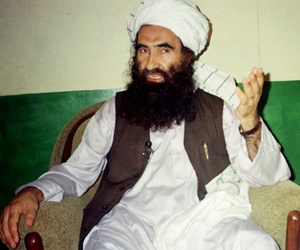 In this Aug. 22, 1998 file photo, Jalaluddin Haqqani, founder of the militant group the Haqqani network, speaks during an interview in Miram Shah, Pakistan.