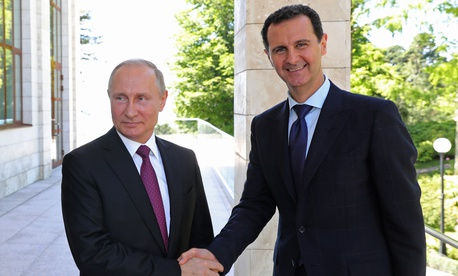 In this May 17, 2018, file photo, Russian President Vladimir Putin, left, shakes hands with Syrian President Bashar al-Assad during their meeting in the Black Sea resort of Sochi, Russia.