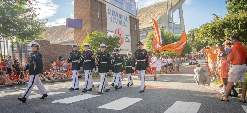 Clemson University's Army ROTC honor guard the Pershing Rifles lead the 2018 First Friday parade past Memorial Stadium on August 31, 2018.